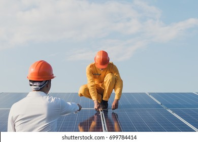 Electrical engineers are checking and repairing. fitting a photovoltaic plant in solar power station alternative energy from nature, Clean Energy,Renewable energy and solar power concept