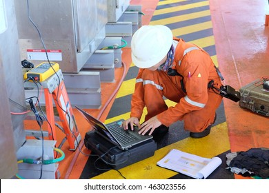 Electrical engineers monitor the operation of the control cabinet .Electrical engineers troubleshooting electrical industrial equipment.