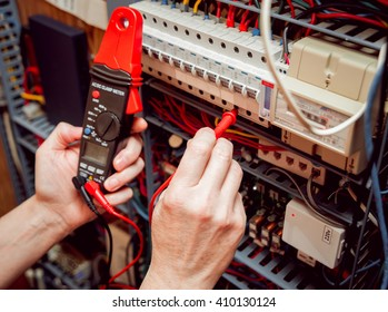 Electrical equipment. Tester in the hands.  Background and texture