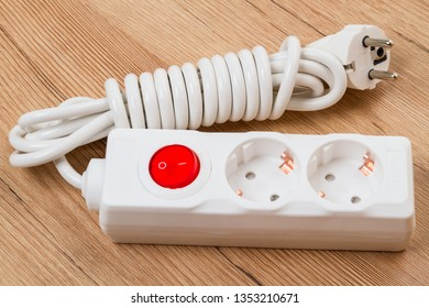 Electrical extension with two sockets and a red switch button