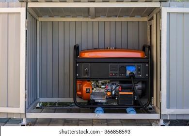 An electrical generator in a metal cupboard