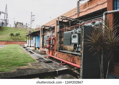 Electrical High voltage transformer (isolate transformer) in a old substation building - Image
