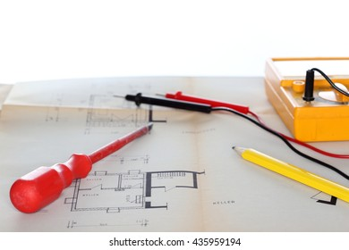 electrical instrument and screwdriver on a plan