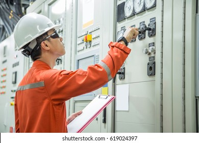 Electrical and Instrument technician checking electricity system which produced by gas turbine engine power generator that install at offshore oil and gas platform.