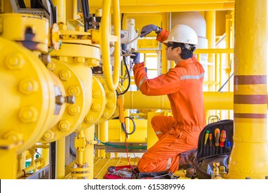 Electrical and Instrument technician fixing and replacing solenoid valve of inlet test separator shutdown valve at offshore oil and gas remote platform.