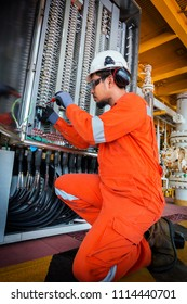 Electrical and instrument technician troubleshooting on programmable logic controller of oil and gas production system