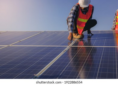 Electrical and instrument technician use wrench to fix and maintenance electric system at solar panel field.