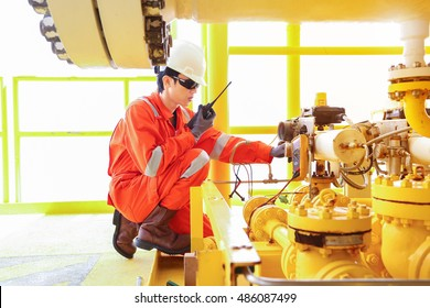 Electrical and Instrument worker use radio to communication to central control room for stroking test shut down valve (SDV) at offshore oil and gas remote platform.