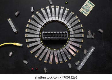 Electrical Internet SFP network modules, network switch, RJ45 ethernet cable, RJ45 connectors, circuit board   with microchips, diodes are on the black background