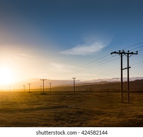 Electrical Lines Fade into the Setting Sun