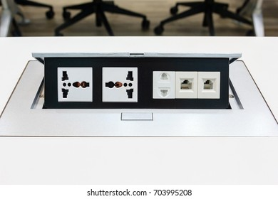 Electrical outlet with dual 3 pin, phone jack plugs and Network plugs on a white table background
