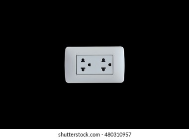 Electrical outlet on a black background