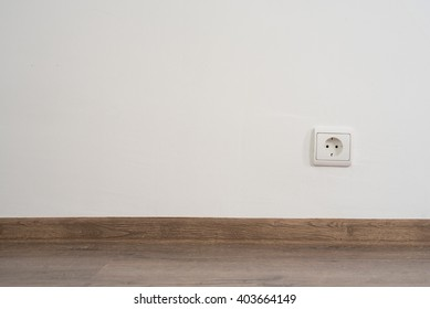 electrical outlet on white wall. home design