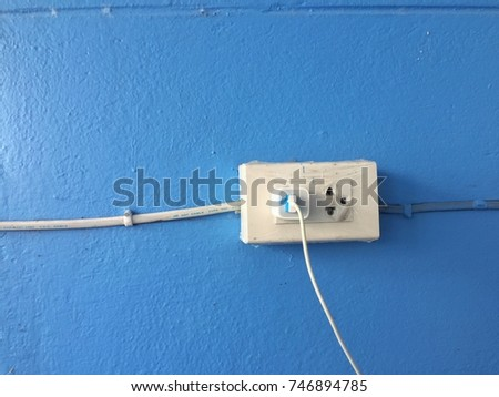 Electrical Outlet Plug On Blue Wall Stock Photo (Royalty Free ...