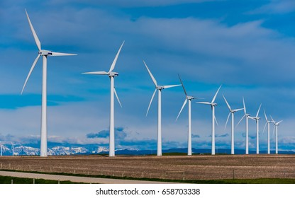 Electrical power generating windmills in the prairies and foothills of the Rocky Mountains Alberta Canada