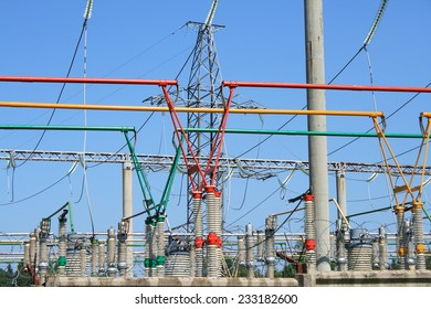 Electrical power high voltage substation encircled with barbed wire fence