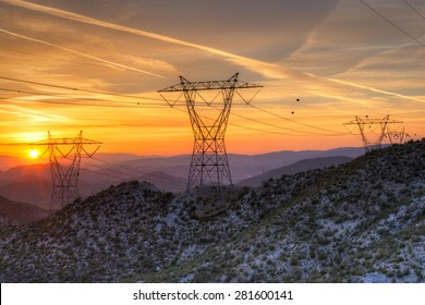 Electrical Power Line Grid Across the Landscape at Sunset, in California.