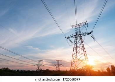 Electrical power lines and towers at sunset.