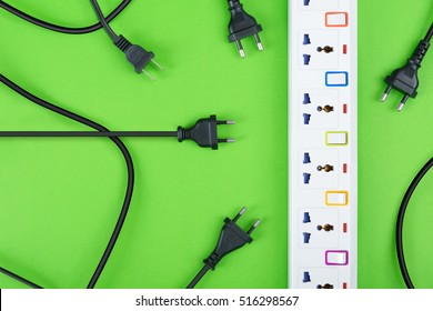 Electrical power strip or extension block and empty outlet tap with switch, grounded top view on colorful background and copy space, electric equipment flat lay concept.