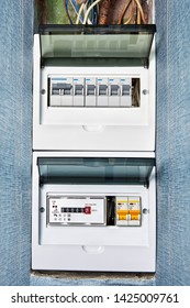 Electrical safety in houses, panel of electrical distribution board with circuit breakers and energy meter. Home electrical system, residential switchboard with fuse box and single phase meter.