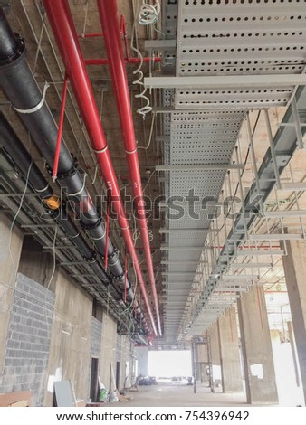electrical sanitary riser system on ceiling stock photo edit now