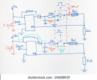 Electrical scheme hand drawn with blue and red pen on the school board as an example during lectures on electrical circuits