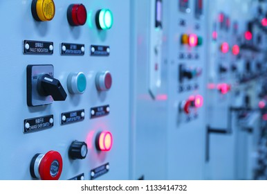 Electrical selector switch,button switch,Electrical switch gear at Low Voltage motor control center cabinet in coal power plant. blurred for background.