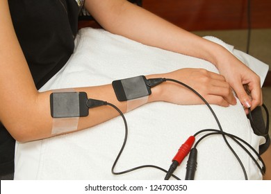 Electrical stimulation forearm ,physical therapist helping woman with electrical stimulator for increase muscle strength and release pain