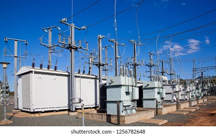 Electrical substation, Pylons and wires distribute power through high voltage trasmission lines. Blue Sky Queensland Australia.