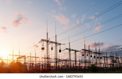Electrical substation silhouette on the dramatic sunset background.