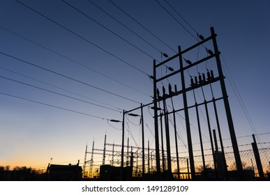 electrical substation or transformer station at sunset