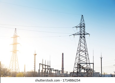Electrical substation with wires and poles during sunset