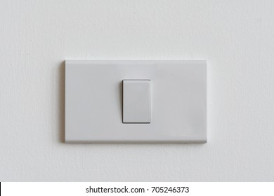 Electrical switch on white wall