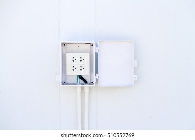 Electrical switch and plug on concrete wall