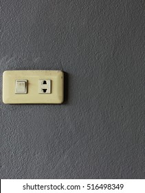 electrical switch and plug on  grey background