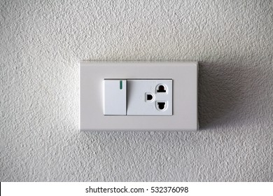 Electrical switch and plug on wall