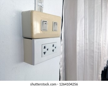 It is an electrical switch and a power outlet,Plug socket, power switch, power outlet.