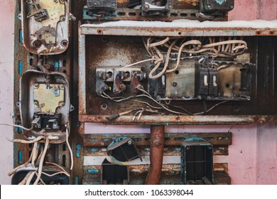 Electrical switchboard. An old, broken, distribution point in an abandoned building. The concept of electrical safety. Work of a professional.