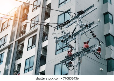 Electrical system for condominium.Connecting the electrical system to the building. The main power source for the electricity system of apartment.High voltage,Electric pole.