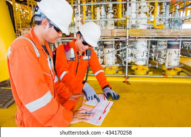 Electrical technician are discussing  about  work permit system of production platform oil and gas flatform