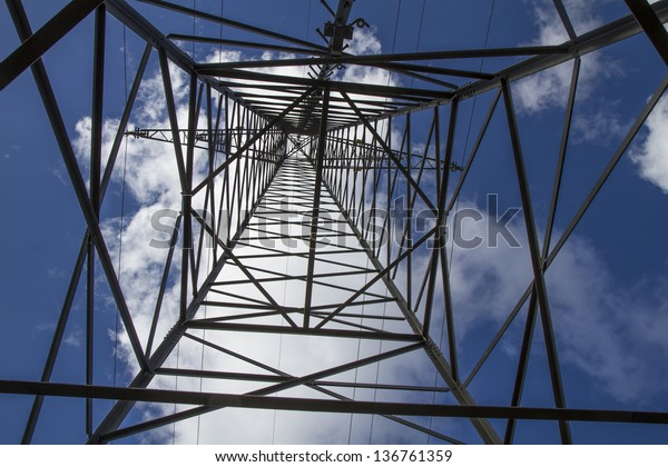 Electrical tower closeup against blue sky