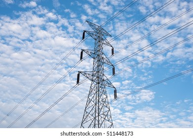 electrical tower in field under blue sky
