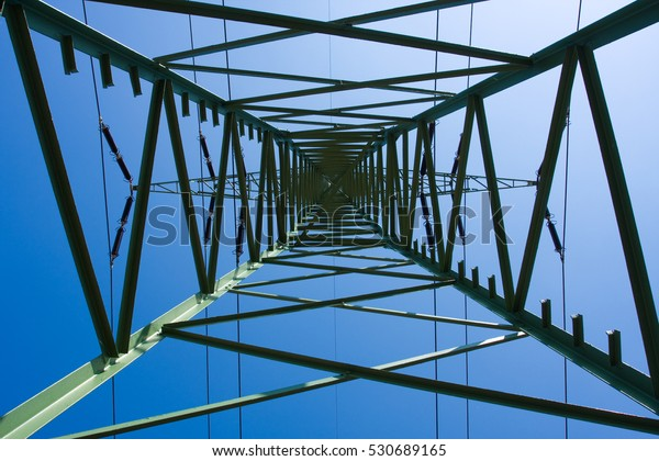 Electrical tower on a background of the blue sky