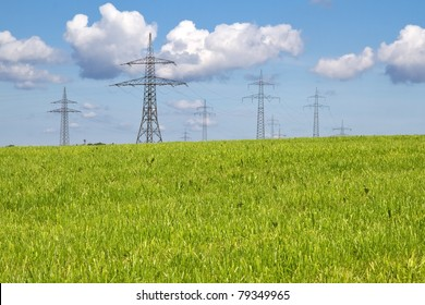 Electrical towers on a meadow in spring time