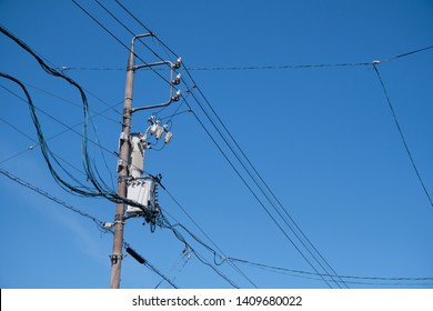 Electrical transformer, High voltage power transformer in town with clear blue sky background