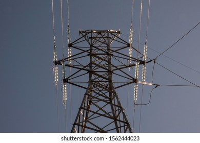 Electrical Transmission Line Tower with Glass Insulators Shining in the Sun