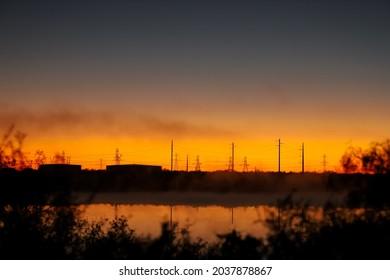 Electrical transmission lines at sunset, Lake Colorado City State Park, Morgan Creek Power Plant, Colorado City, Texas, USA. Land of Kiikaapoi, Jumanos, Ndé Kónitsąąíí Gokíyaa (Lipan Apache), Nʉmʉnʉʉ