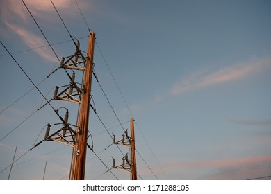 Electrical utility poles and overhead power supply lines in Wyoming / USA.
