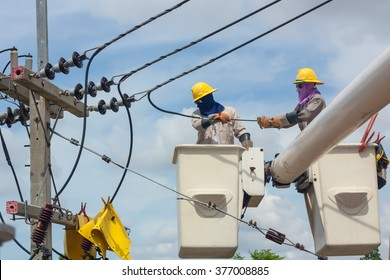 electrical utility worker in a bucket fixes a problem with a power line.