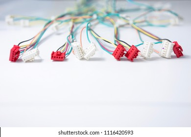 Electrical wire harness with plastic housing connector on white background isolate